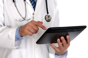 bigstock-doctor-using-a-digital-tablet--31270601