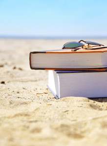 bigstock-vacation-beach-with-books-in-s-33452963